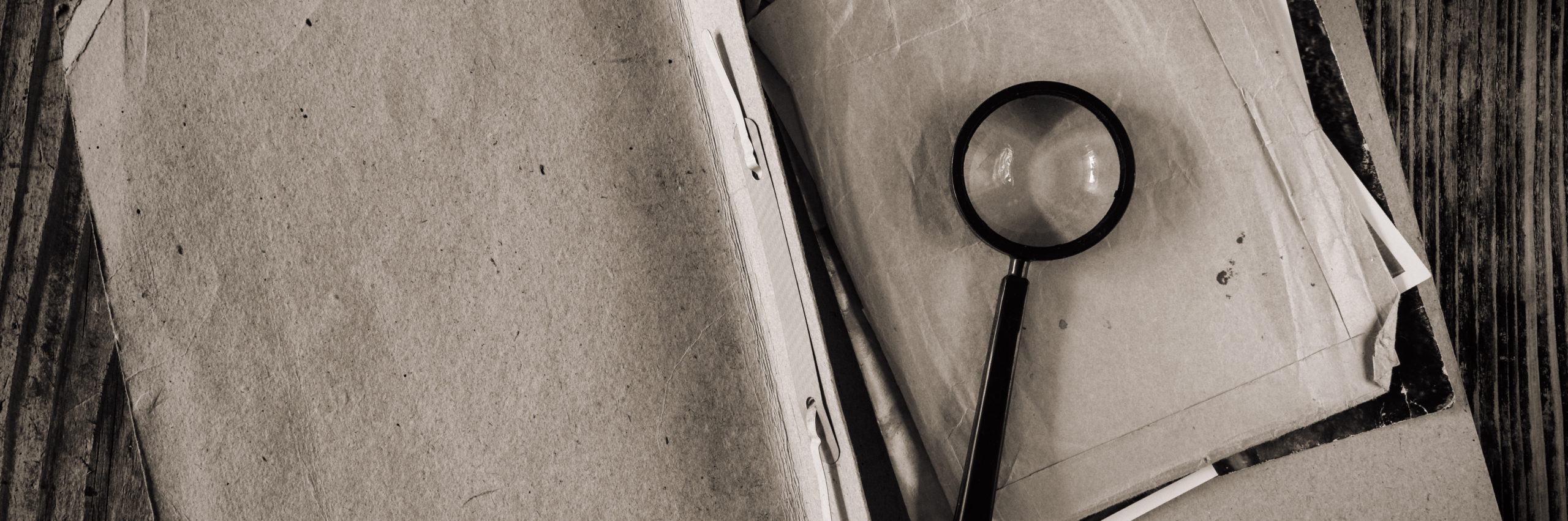 Magnifying glass with vintage documents retro investigation spy discovery concept - Image
