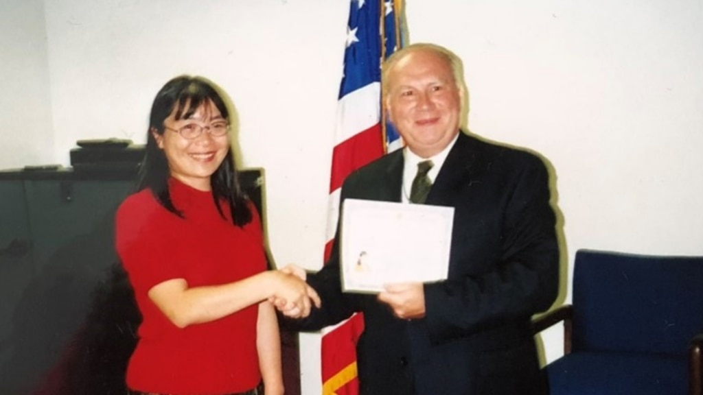 Foreign Service Officer and author Chunnong Saeger is naturalized as a U.S. Citizen in September 2001. (Photo courtesy of the author)